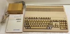 Commodore Amiga 500 with PSU and Manual. Powers On. World Wide Shipping. 16 bit