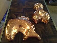 Pair of copper color wall hanging molds
