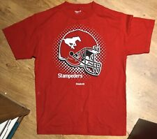 CALGARY STAMPEDERS CFL CANADIAN FOOTBALL OFFICIAL REEBOK RED T-SHIRT - SIZE M