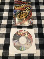 RollerCoaster Tycoon 2 Disc and Manual Six Flags Infogrames (Windows PC, 2002)