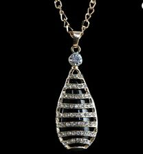 Long Silver Teardrop Pendant Necklace with Crystals