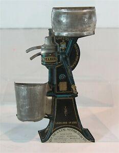 1908 DE LAVAL CREAM SEPARATOR FIGURAL WALL MOUNT TIN LITHO MATCH HOLDER