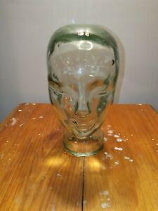 Green glass head mannequin