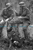 F002277 German soldiers with German Shepherd war dog. 1942