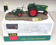 WISCONSIN FARMS OLIVER 77 DIESEL TRACTOR WITH 2-14 RAYDEX PLOW AND STAND **