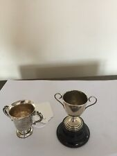 TWO SMALL TROPHY CUPS  COMBINED WEIGHT INCLUDING THE STAND 65GRAMS
