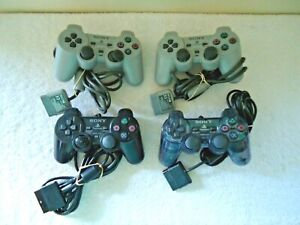 Lot Of 4 Sony Playstation Controllers,2,SCPH-1200,2,SCPH-10010 Dual Shock 2