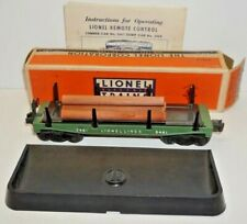 LIONEL LINES WORKING NO. 3461 GREEN OPERATING LUMBER CAR WITH LOGS & NO.160 BIN