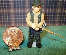 About 1/4'' scale standing fishing man 1 5/8'' tall