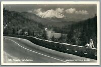 RPPC Postcard Mt Shasta Ca woman sitting on a wall looking at mountain Eastman's