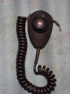 Handheld microphone by Roanwell, with PTT switch and curly cord