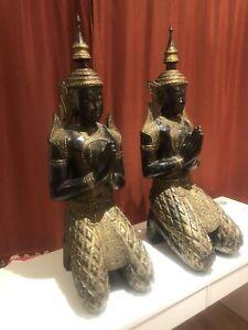 Thai Wooden Statues. Praying Buddha.
