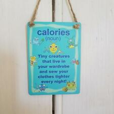 CALORIES CREATURES IN YOUR WARDROBE & SEW YOUR CLOTHES TIGHTER MINI METAL SIGN