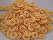 LOT OF 100 LIGHT ORANGE SWIRL COLOR 4 HOLE 9/16 INCH BUTTONS, NEW
