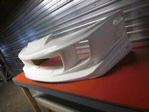 Fiberglass SF1 Style Front Bumper for a 95-98 Eagle Talon 3DR