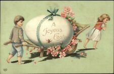 Easter - Children w/ Giant Egg on Wagon c1910 Postcard