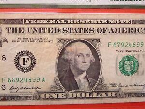 $1 1969 federal reserve note graded error:  mismatched serial number  26-044