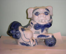 Vintage Blue on White Glazed Ceramic Lion of Foo Dog rolling ball in mouth