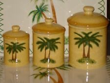 """Palm Tree canister set. Set of 3 measures  10"""", 8 1/2"""" and 7"""" tall with seals."""