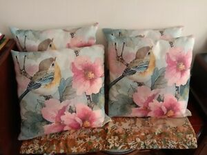 4 matching cushions with bird and flowers in pinks, blues, green, yellow