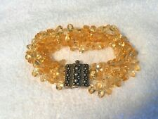 Exquisite 4 strand faceted oval Citrine beaded bracelet with statement SS clasp