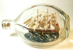 NICE ANTIQUE MODEL WARSHIP IN A BOTTLE NAMED WITH FLYING SEAGULLS