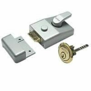 CONTEMPORARY SILVER STANDARD NIGHT LATCH WITH BRASS CYLINDER KEY AND FITTINGS