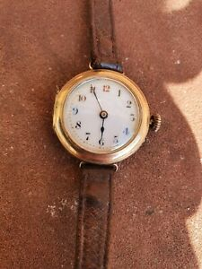 Ladies antique 9ct gold watch. Pin set. Full working order. Enamel Red 12 watch