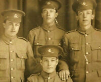 WWI NEWFOUNDLAND REGIMENT REAL PHOTO POSTCARD - FOUR VERY YOUNG NFLD BOYS
