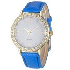Ladies Fashion Gold Quartz Pale Blue Face and Crystal Blue Band Wrist Watch.