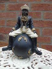 statue d un noir assis sur boule ,  nouveau ! art déco .