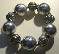 Bracelet Elasticated various Beaded in silver tone plastic deliberately distress