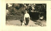 Antique (c.1910s) Young Man Walking Beagle Dog in the Park Real Photo Postcard