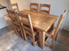 Solid oak dining table and 6 chairs used