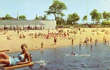 PICNIC GROVE AND BEACH AT ISLAND BEACH, GREENWICH, CT. woman on diving board