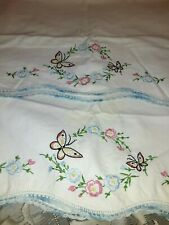 Beautiful embroidered Butterfly's & Flowers on Vintage pillow cases