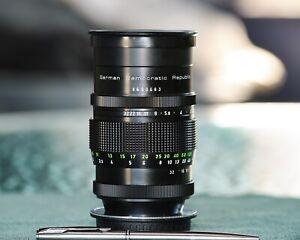 Pentacon 135mm f/2.8 M42 15 blade version with Canon EF adaptor/ hood/case.