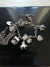 vintage silver charm bracelet.hallmarked.silver charm bracelet. 7 charms.39 gram