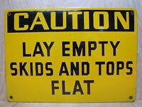 CAUTION LAY EMPTY SKIDS AND TOPS FLAT Old Porcelain Sign Yellow Black Industrial