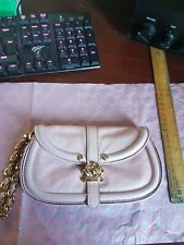 Juicy Couture Baby Pink leather wristlet with gold crown detail.