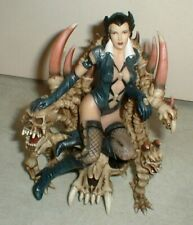 Sexy Fantasy Witch Figure Statue sitting on Dragon Skeleton Skull Throne Chair
