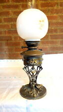 """VICTORIAN"". Oil Lamp Supported on 3 - Floral Supports c1890 - 1910."