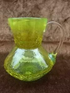 M393 / ANTIQUE SMALL HAND BLOWN URANIUM GLASS JUG WITH CLEAR GLASS HANDLE