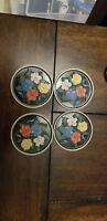 4 vintage metal floral textured coasters circle round