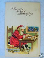 SANTA CLAUS SITTING W/ PEN! WISHING YOU THE BEST OF CHRISTMAS JOYS!  POSTCARD