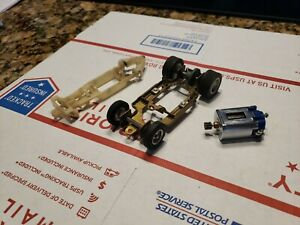 2 Vintage 1/24 Scale Slot Car Chassis and a Motor.   L@@k