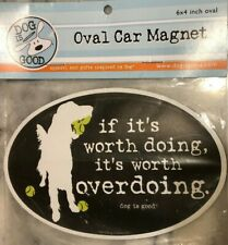 "Oval Car Magnet- ""If it's worth doing, it's worth overdoing."" Dog & tennis balls"