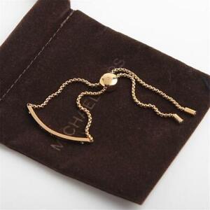 Michael Kors Logo Plaque Gold Tone Crystal Set Slider Bracelet
