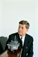 John F.Kennedy photographed in 1961 with a replica of PT 109 at the White House.