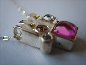 A Contemporary Style Sterling Silver Pendant Necklace.